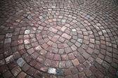 Granit kaldırım taşı döşeli yol. arka plan doku — Stok fotoğraf