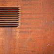Royalty-Free Stock Photo: Metal rusted wall with ventilation