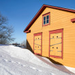 Rural yellow wooden house in winter season — Stock Photo #9673459