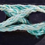 Bundle of rope on the bollard — Stock Photo #9686425