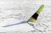 Black and yellow buoy on frozen Baltic sea — Stok fotoğraf