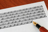 Writing binary code by a fountain pen — Stock fotografie