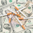 Cigarettes are in U.S. dollars — Stock Photo