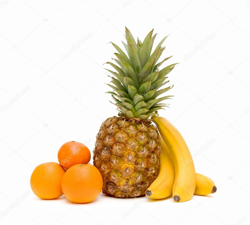 Fresh fruit: oranges, pineapples and bananas on white background close-up. — Stock Photo #8259463