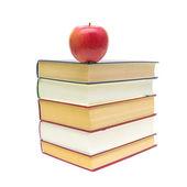 červené jablko a stoh knih izolovaných na bílém pozadí — Stock fotografie