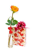 Rose and a gift on white background — Stock Photo