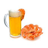 A glass of light beer and prawns on a white background — Stock Photo