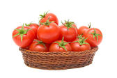 Tomatoes in a basket on a white background — Stock Photo
