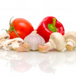 Mushrooms, tomatoes, garlic and peppers on a white background — Stock Photo