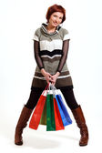Attractive woman holding shopping bags — Stock Photo