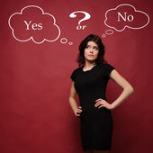 Attractive young woman thinking yes or no — Stock Photo