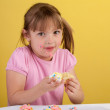 Silly girl eating a cupcake — Stock Photo #10146640