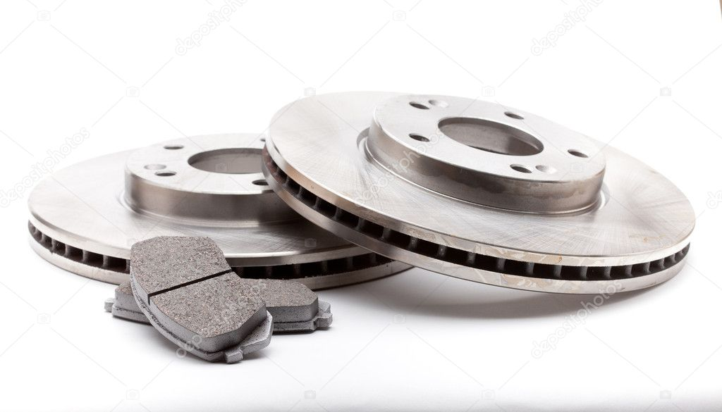New front brake disks and pads for a modern car  Stock Photo #10146673