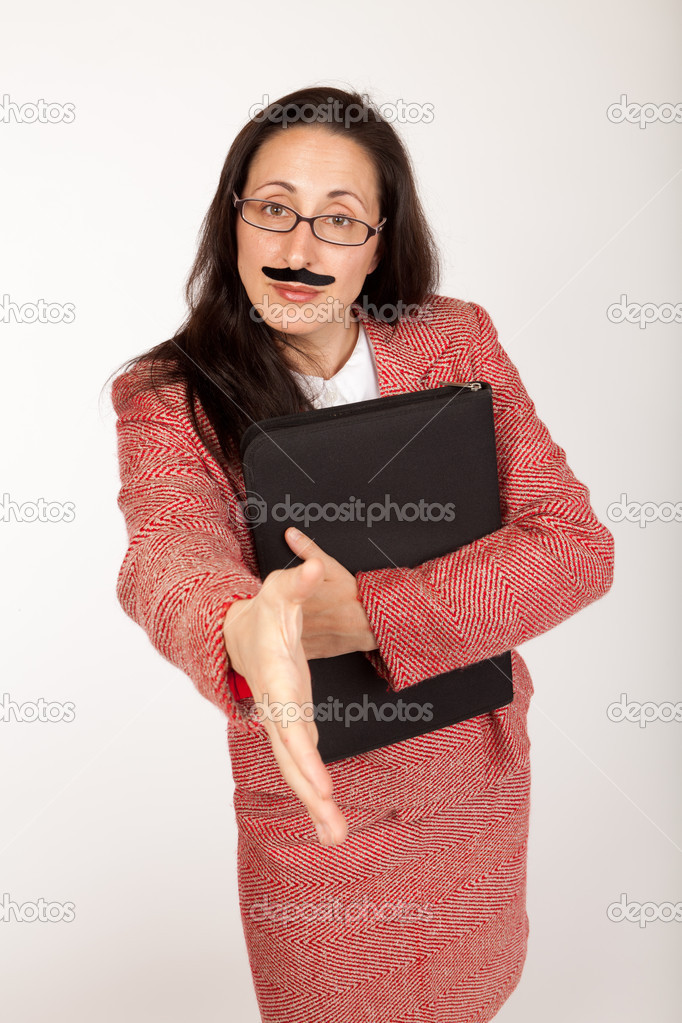 Humorous shot of a silly looking businesswoman with a binder and a fake mustache  Stock Photo #10293014