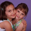 Two Cute little girl hugging — Stock Photo #10643175
