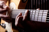 Close up shot of a man playing guitar — Stock Photo