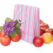 Apples, package and flowers — Stock Photo