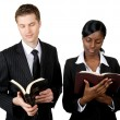Multi-ethnic business couple reading bibles — Stock Photo #8275295