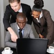 Stock Photo: Multi-ethnic business team working on laptop