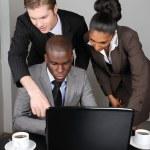 Multi-ethnic business team working on laptop — Stock Photo #8275324