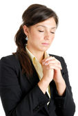 Young business woman praying — Stock Photo