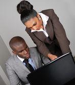 Multi-ethnic business team working on laptop — Stock Photo