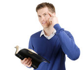 Committed christian reading bible and thinking — Stock Photo