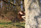 Pretty girl playing hide and seek — Stock Photo