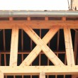 Wood frame of house under construction — Stock Photo #10493294
