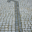 Stock Photo: Cobbled road with arrow as background