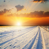 Winter landscape. sunset over road with snow — Stock Photo