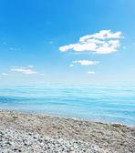 Stones on beach, sea and blue sky. Crimea, Ukraine — Stock Photo