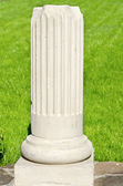 Bottom of white ionic column — Stock Photo