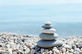 Stack of zen stones on beach — Stock Photo