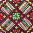 Embroidered good by cross-stitch pattern - Стоковая фотография