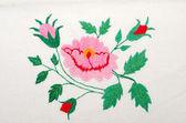 Roses as handicraft embroidery good — Fotografia Stock