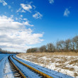 Railroad to sunset. winter time — Stockfoto