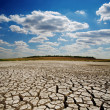 Cracked earth under dramatic sky — Stock Photo #9490544