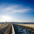 Railroad to horizon under deep blue sky in sunset — Stock Photo