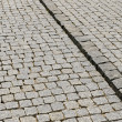 Stock Photo: Cobbled road as background