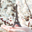 Tiny Eiffel tower on the hands, dreams of about traveling in Par — Stock Photo
