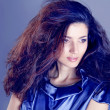 Stock Photo: Fashion Brunette over blue . Beautiful Makeup and Healthy Black Hair