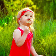 Outdoors Portrait of funny lovely little girl in red dress — Stock Photo #10652620
