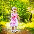Happy funny little girl walking on road, nature outdoors — Stock Photo #10652621