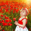 Happy smiling little fun girl in poppies field, sunset outdoors portrait — Stock Photo