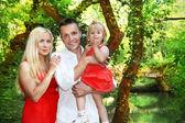 Happy family having fun, green outdoors — Stock Photo