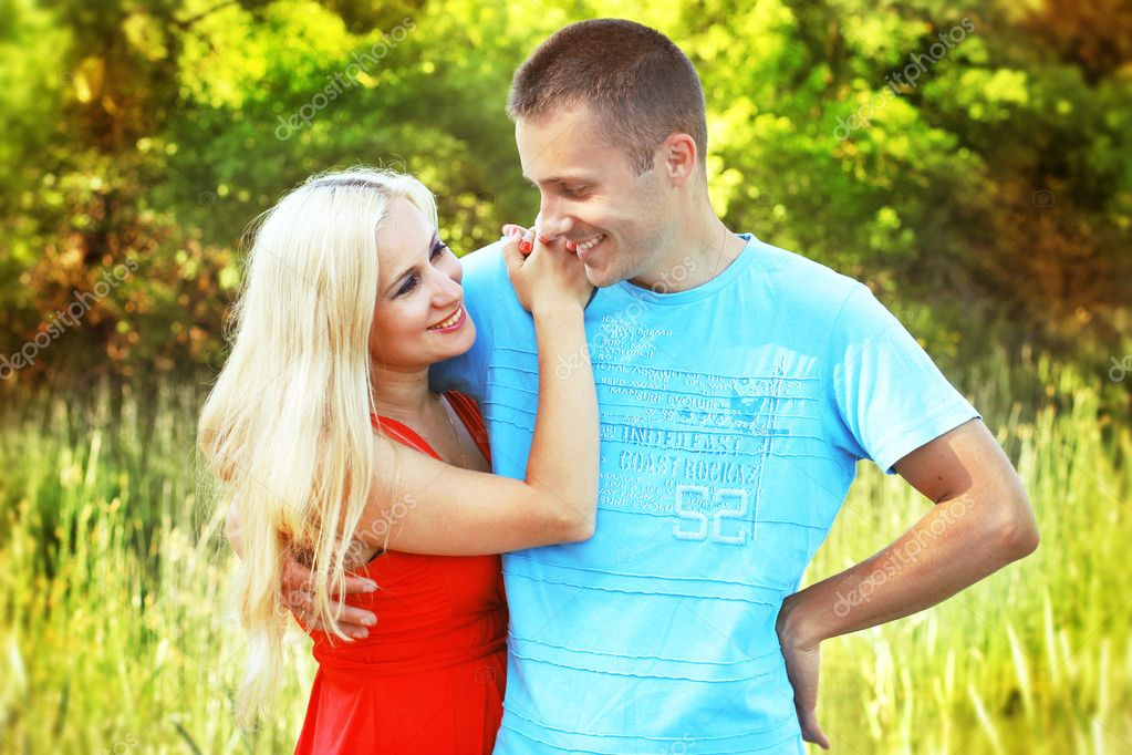 Closeup portrait of happy couple enjoying vacations on outdoors  Stock Photo #10652604