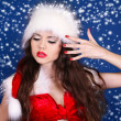 Girl in Santa Claus red dress posing on snow background — Stock Photo #8003514