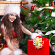 Portrait of beautiful happy girl wearing Santa Claus clothes — ストック写真