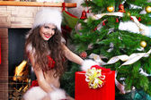 Portrait of beautiful happy girl wearing Santa Claus clothes — Stock Photo